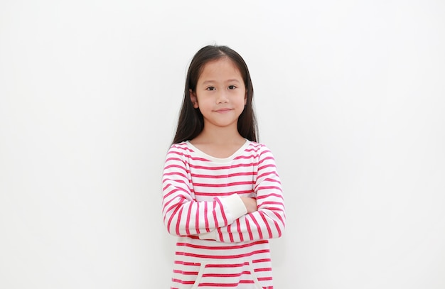 Asian little kid girl crossed arms with smiling on white background