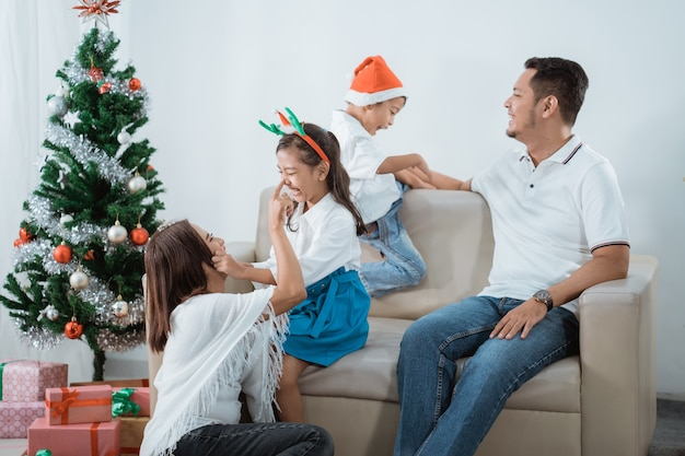 Asian lovely family with christmas tree in their living room