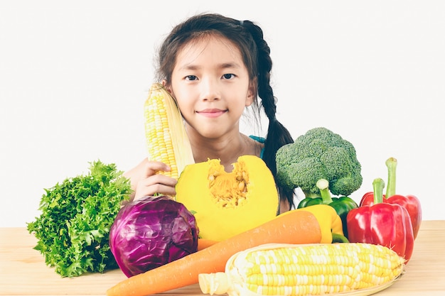 Asian lovely girl showing enjoy expression with fresh colorful vegetables
