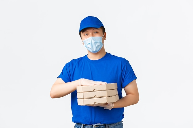 Asian male courier in blue uniform
