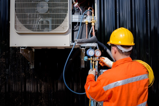 Asian male electricians inspect electrical systems in buildings