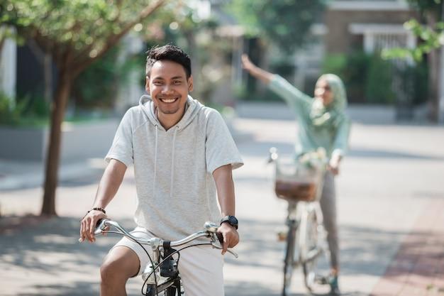 Asian male riding a bike