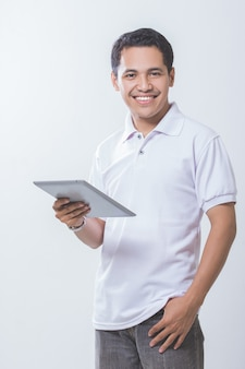 Asian male using tablet