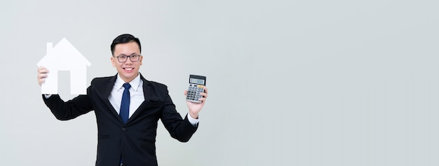 Asian man agent showing house model with calculator