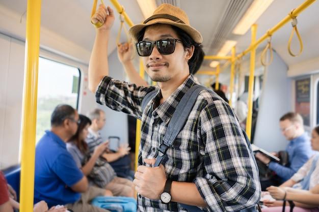 Asian man bag pack tourist in a train.