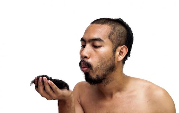 Asian man blowing his hair from haircut.