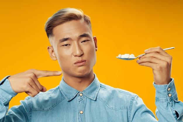 Asian man on bright color  posing model, coronavirus