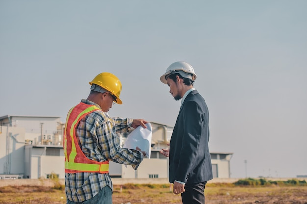 Asian man business talking outdoor on site construction