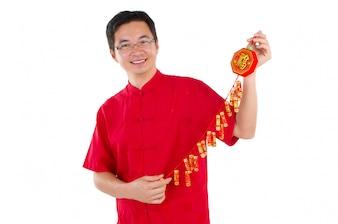 Азиатский человек празднует китайский Новый год
