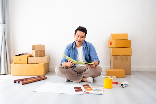Asian man design and thinking to decorate home