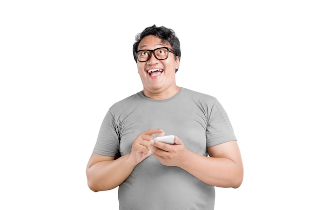Asian man in eyeglasses with excited expression isolated over white background