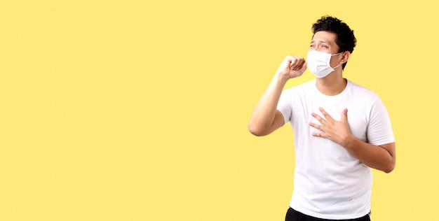 Asian man feel pain on lung and wear protective mask pollution or transmissible infectious diseas and coronavirus or covid-19, healthcare and illness concep