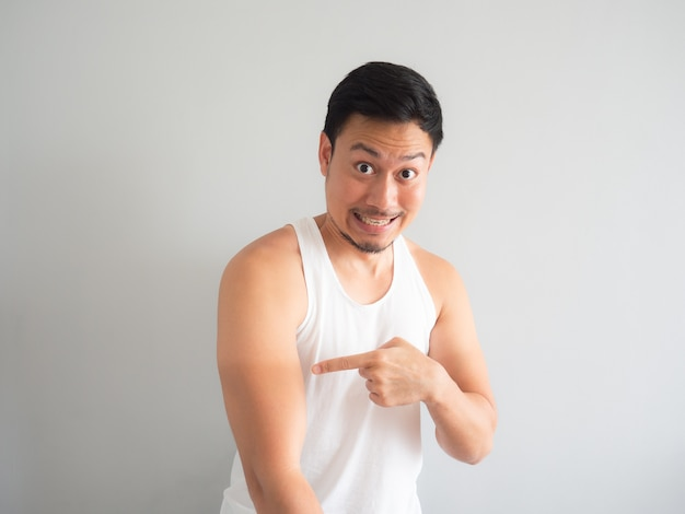 Asian man get tanned on the arm.