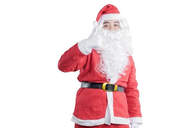 흰색 배경 위에 절연 서 엄지 손가락을 보여주는 산타 의상 아시아 남자
