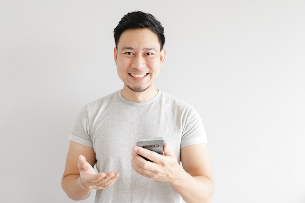 Asian man is feeling happy with the application in the smartphone.