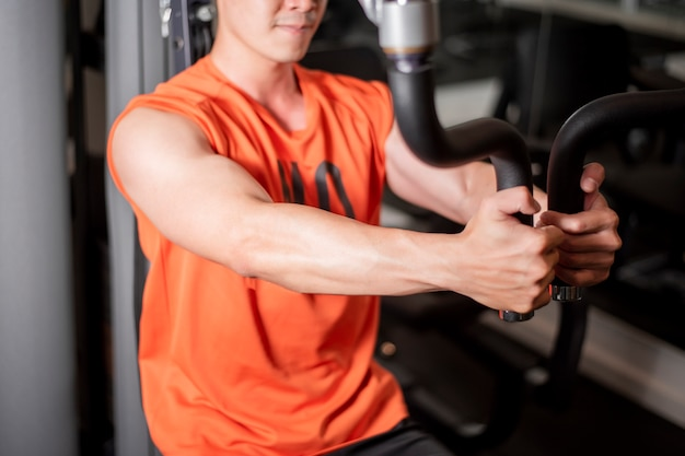 Asian man is working out  in fitness gym