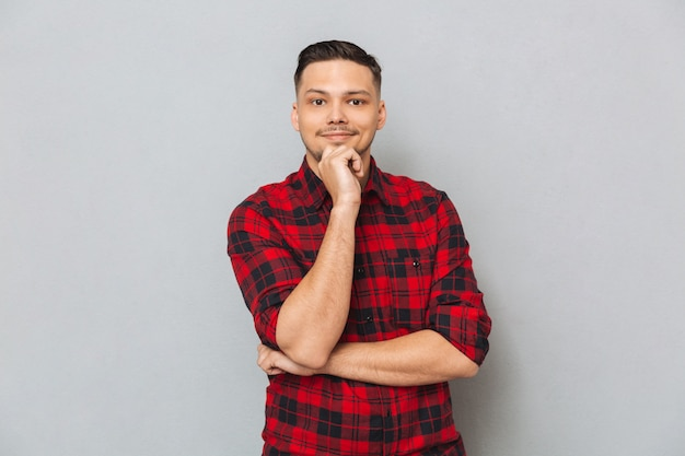 Asian man looking camera isolated