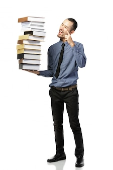 Asian man opened mouth dressed in formal wear with books .
