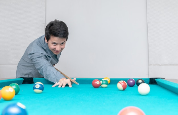 Asian man playing billards, sport and recreation