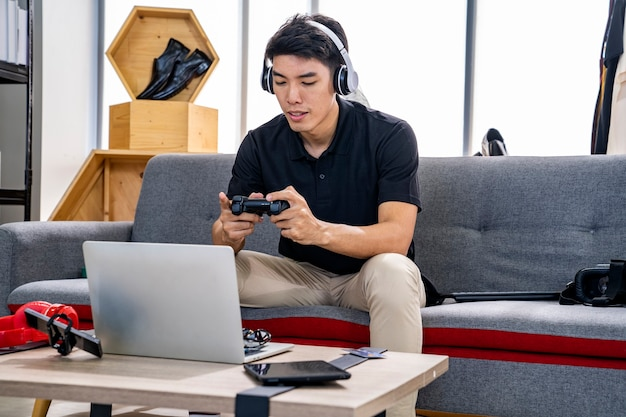 Asian man playing games online