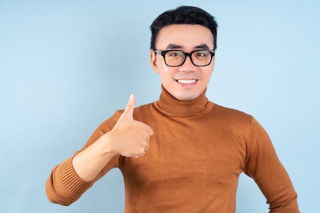 Asian man posing on blue background