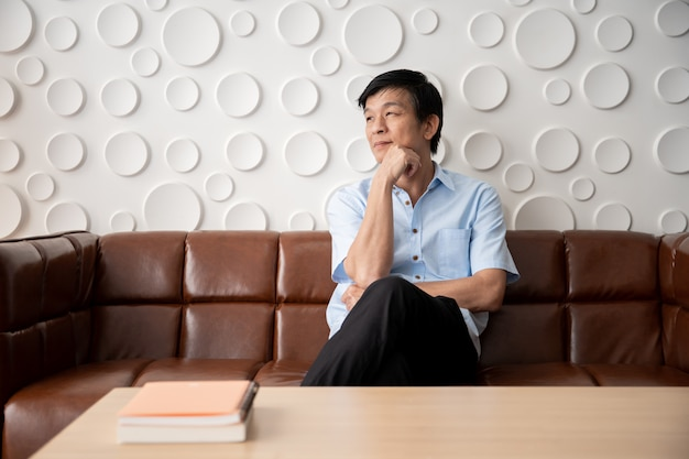 Asian man relaxing in the living room