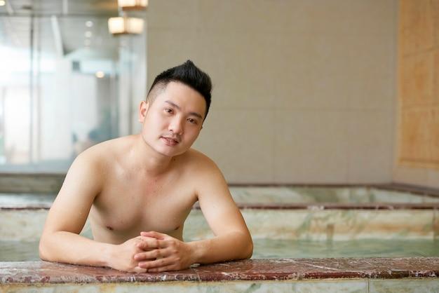 Asian man at spa resort