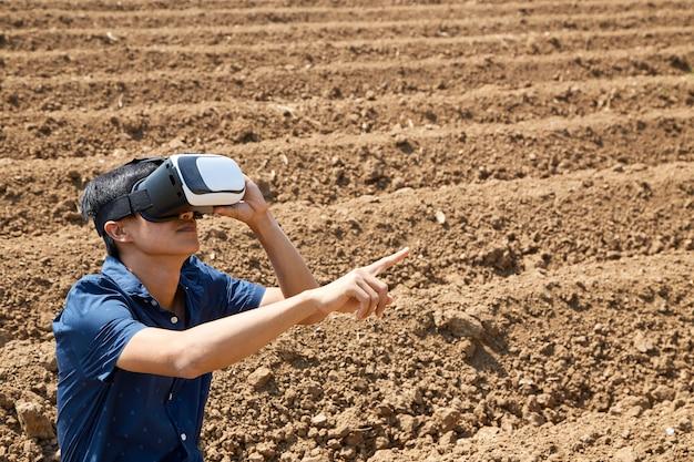 Asian man using the virtual reality headset