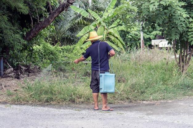 Asian man watering his garden