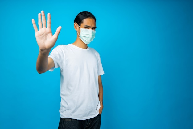 Asian man wearing face mask to protect coronavirus