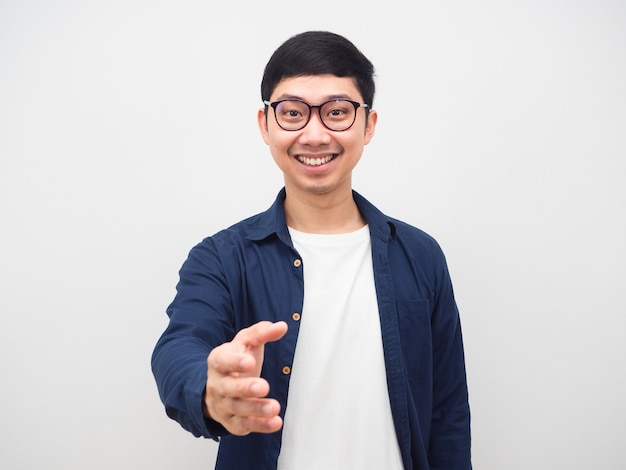Asian man wearing glasses happy smile give hand to you portriat white background