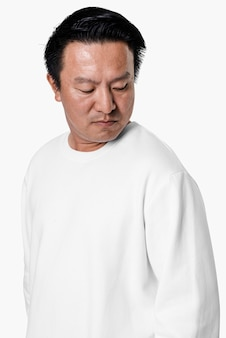Asian man wearing white sweater close-up