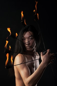 Asian man with fire show