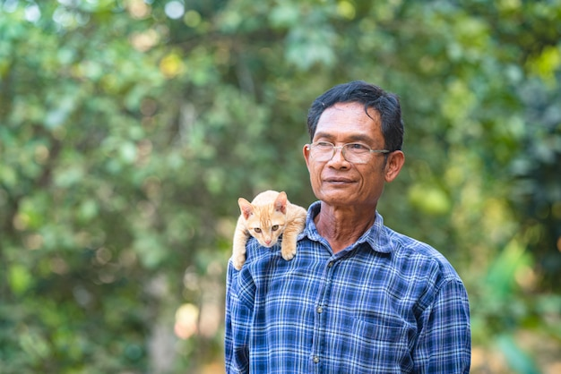 Asian man with little cat