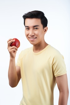 Asian man with red apple
