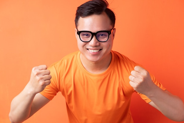Asian man with a triumphant expression