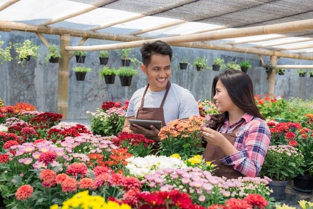 Asian man and woman florist