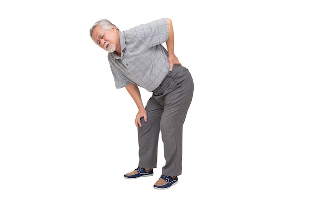 Asian mature man feels back pain isolated on white wall, sad senior older man suffers from low-back lumbar pain, backache concept