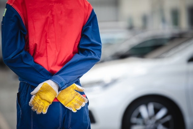 Asian mechanics wear their racing suits to turn back in repair shops and car repair centers.
