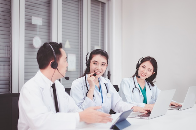 Asian medical call center team working together at hospital,international medical service center