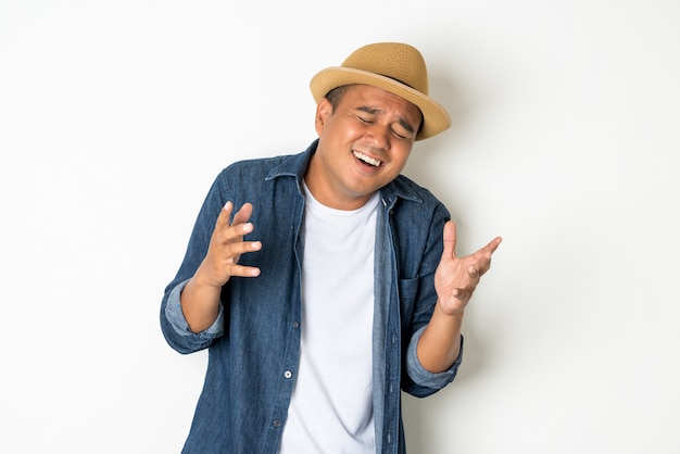 Asian men aged around 30 wearing hats and jeans. standing laughing happily