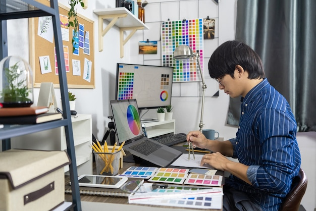 Asian men architect work for renovation, creative occupation design studio concept.