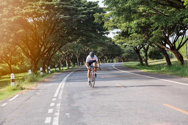 Asian men, cyclists are exercising in the evening.