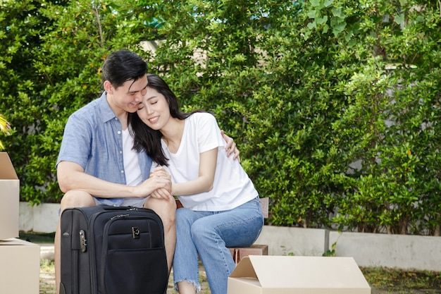 Asian men and women couple moving into a new home. they are happy to build a family together. concept of starting a married life create a happy family. copy space