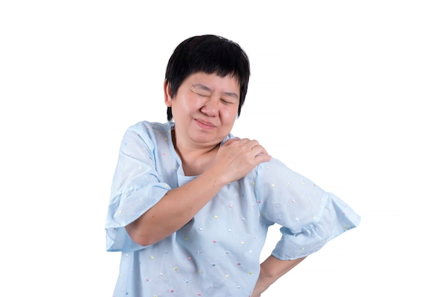 Asian middle-aged woman suffering from frozen shoulder and lower back pain isolated on white background