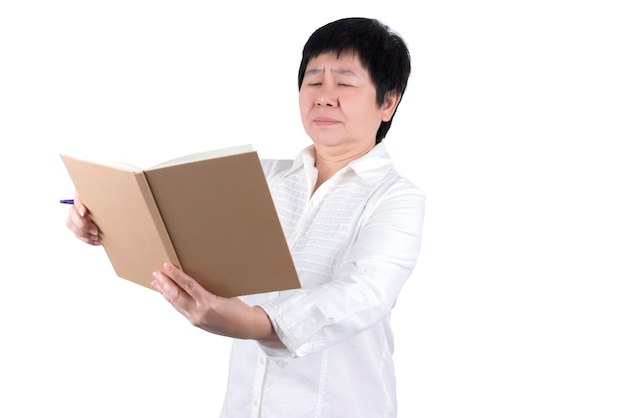 Asian middle-aged woman in white shirt having vision problems in writing or reading isolated on white background , eyesight concept