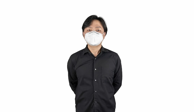 Asian middle man in a black shirt wears a white n mask stands in front of a white clear background