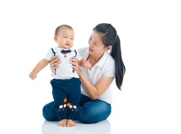 Asian mother playing with baby boy