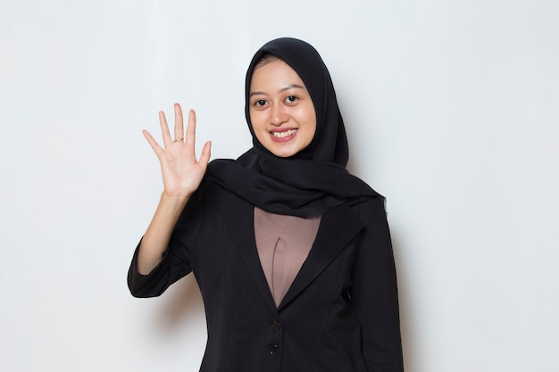 Asian muslim business woman in hijab say hello Premium Photo