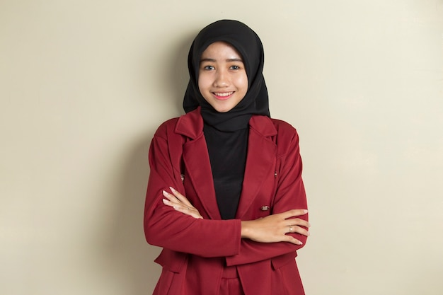 Asian muslim business woman wearing hijab with formal outfit and elegant appearance.